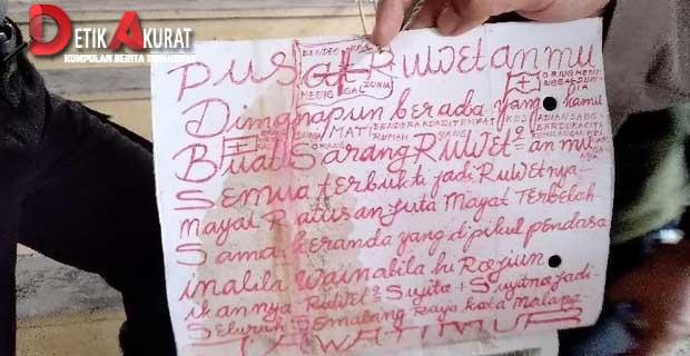 kertas-tulisan-berwarna-merah-ditemukan-di-lokasi-mayat-mutilasi