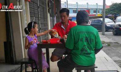 menghangatkan-viral-foto-ayah-dan-anak-ajak-gelandangan-makan-bareng